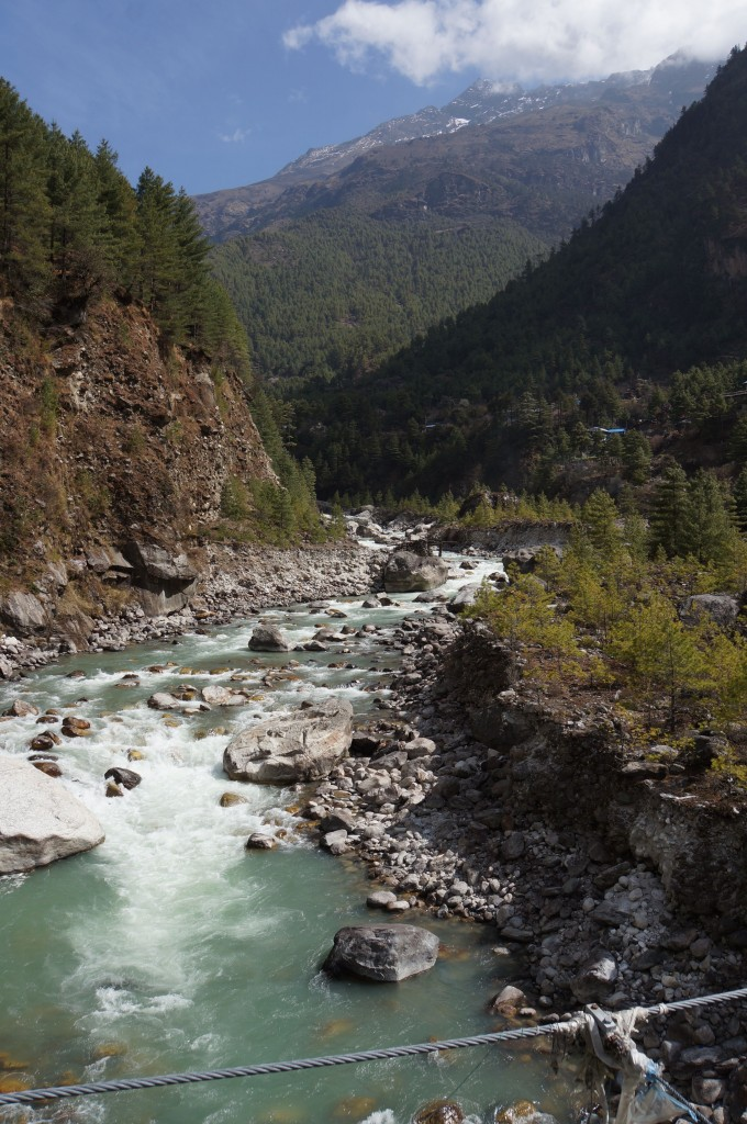 "The water of the Dudh Kosi is frigid and beautiful, and filled with lots of granite silt from the grinding action of the glaciers far above.  Sometimes it is called ""glacial milk."""