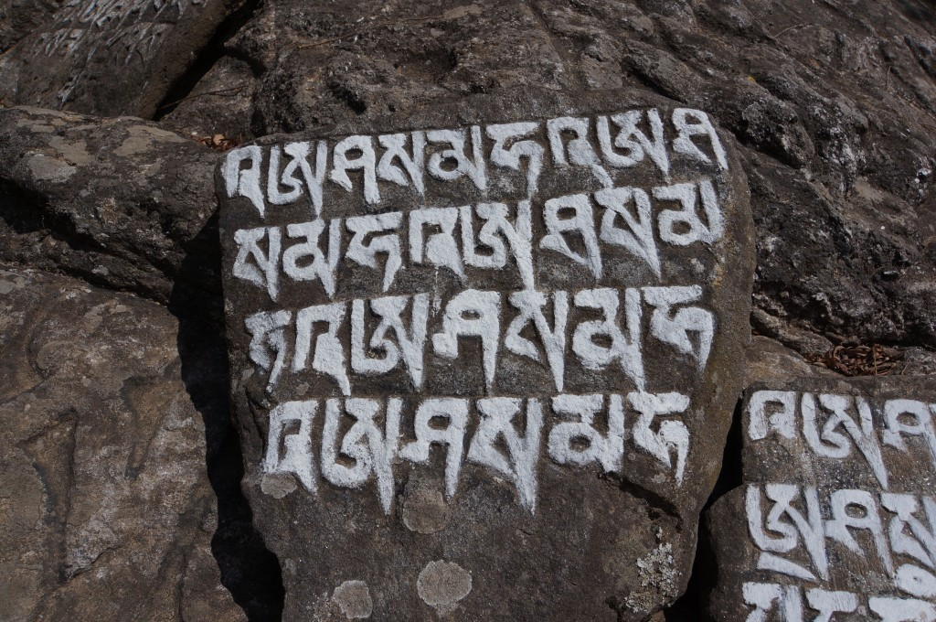 The influence of Buddhism is evident everywhere, including prayers carved and painted into the very living rock.