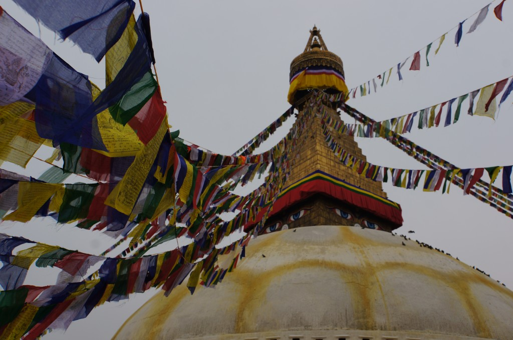 Traditional Tibetan prayer flags stream from the top of the temple.