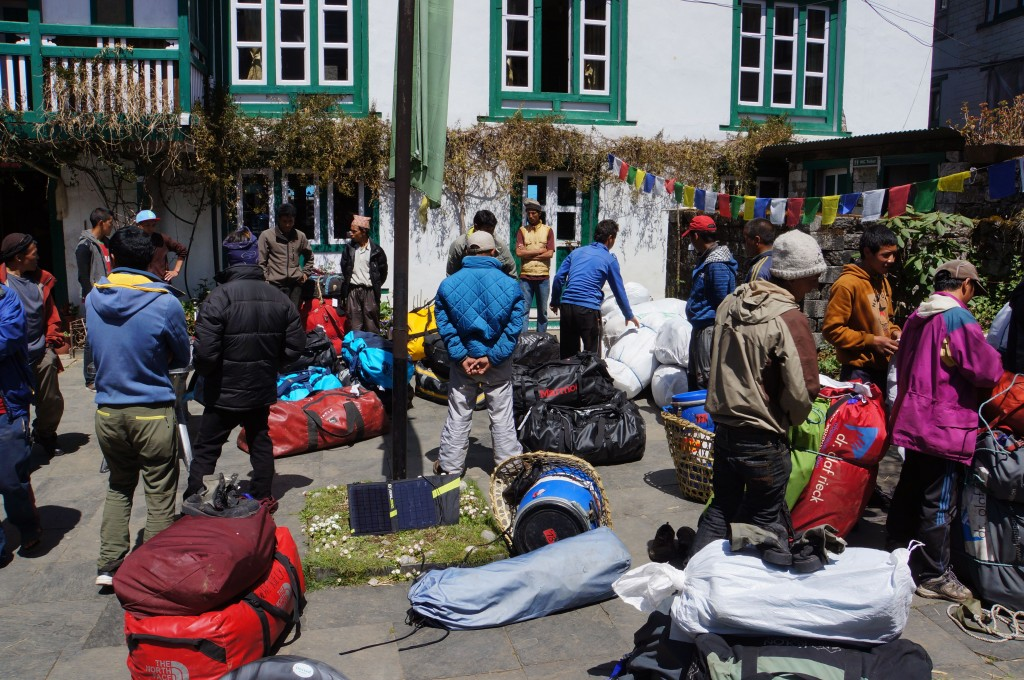 The amazing porters organize gear into manageable loads.