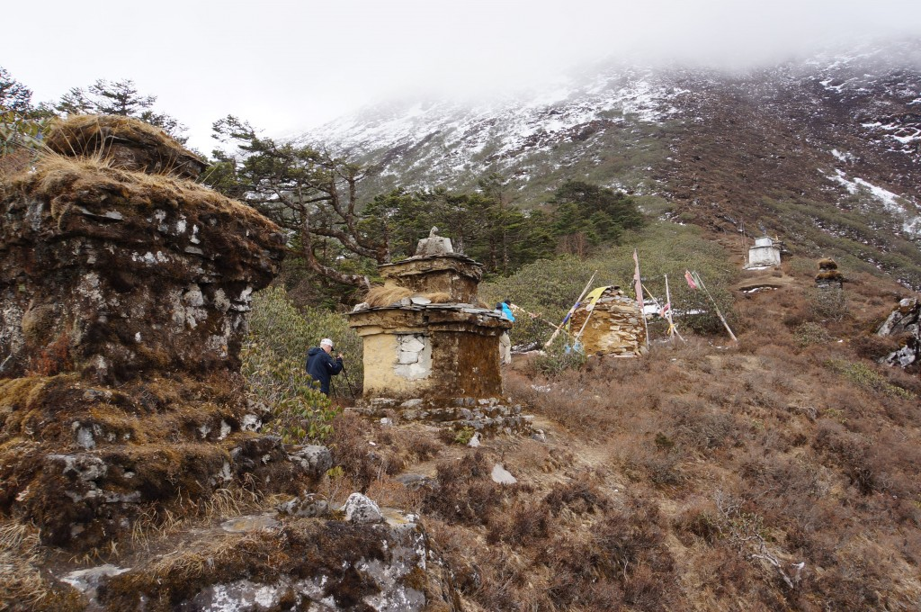 Chortens lead up to the clouds.