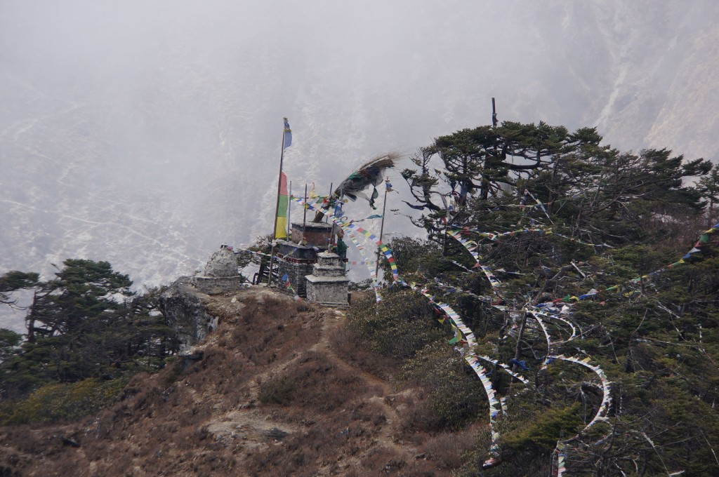Numerous chortens with prayer flags adorn the ridge.
