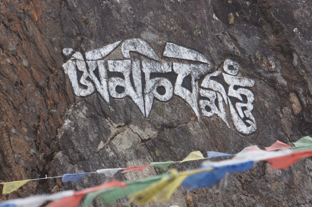Prayer carved into the rock above town.