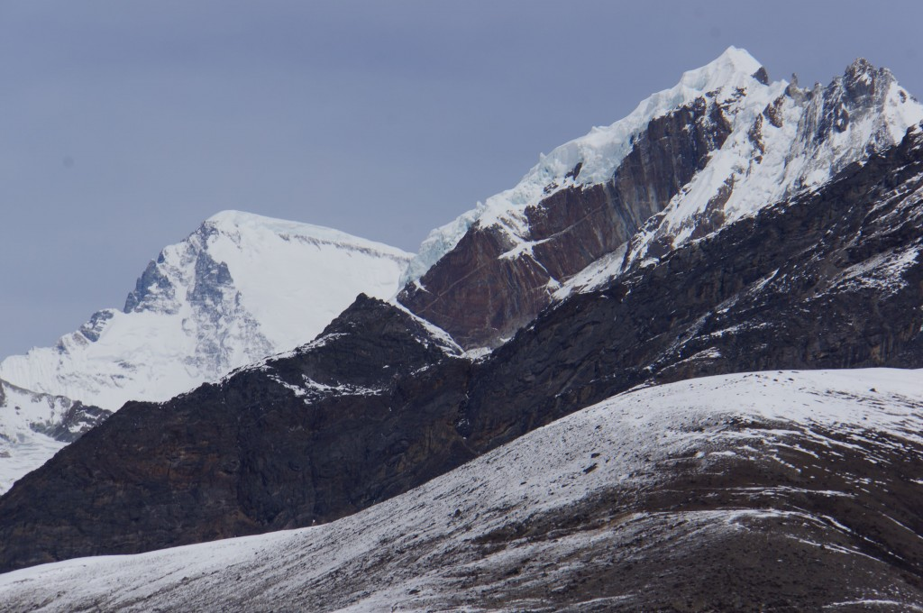 Cho Oyu is the broad corniced snow peak in the background, one of the world's fourteen peaks above 8,000 meters.