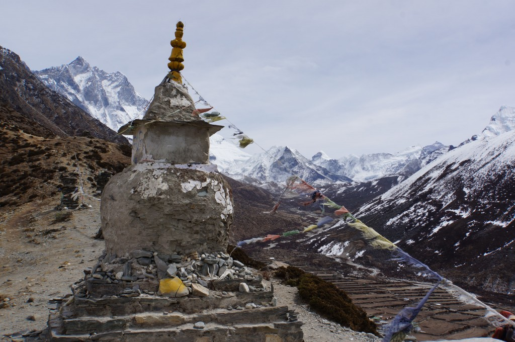 A stupa stands watch over the valley below.