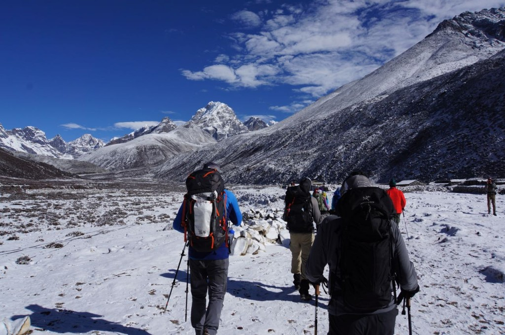 We move towards Lobuche under clear skies, on frozen ground.