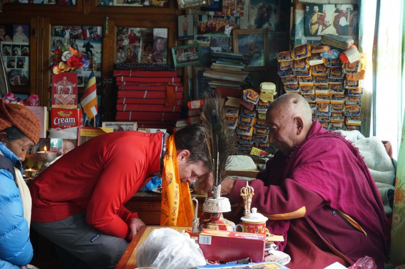 I receive a blessing of safe passage from Lama Geshi.  (Photo: Justin Merle)