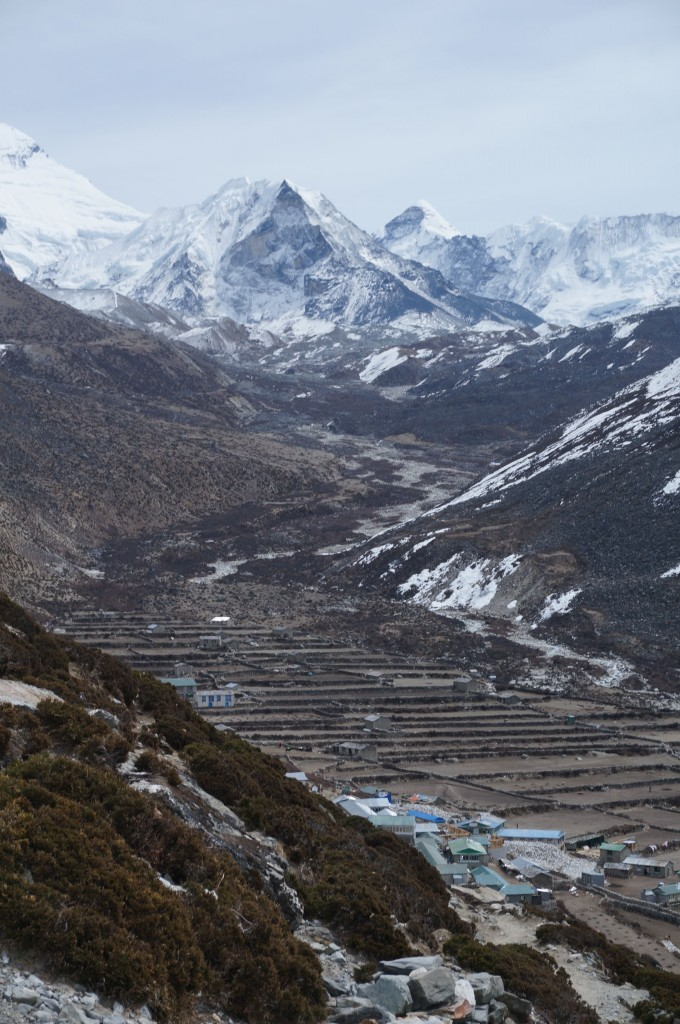 Dingboche town lies on the other side of the scree slope.  Island peak looms above.
