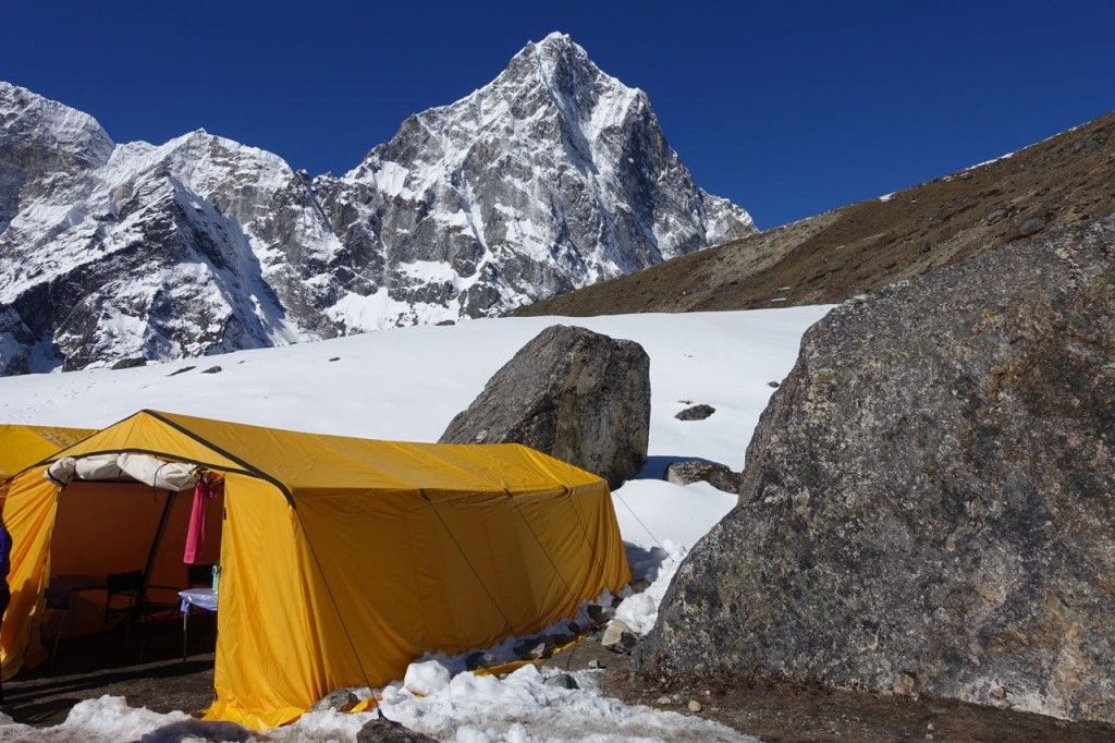 The dining tents have no floors, inviting rivers of snowmelt during the day.  (Photo: Blake Penson)