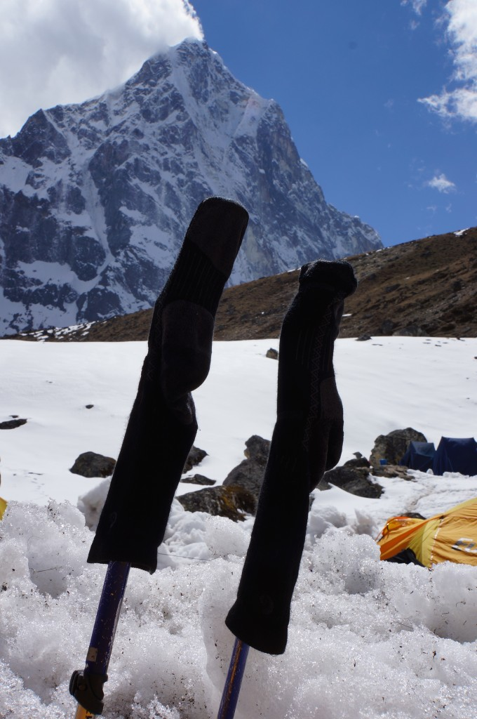 Trekking poles make a great way to dry socks.
