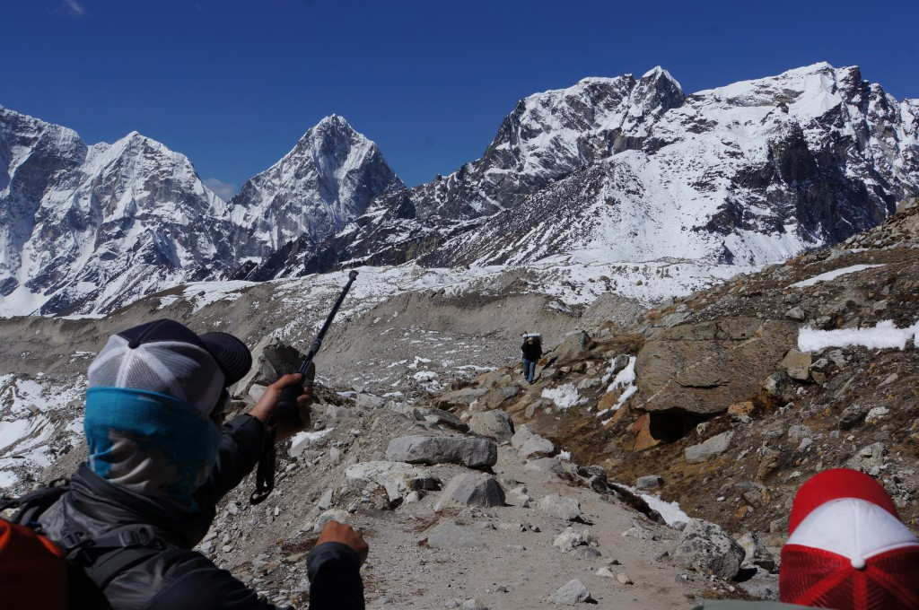 Andy shows our next objective: The central snow hump on the ridgeline of Lobuche.