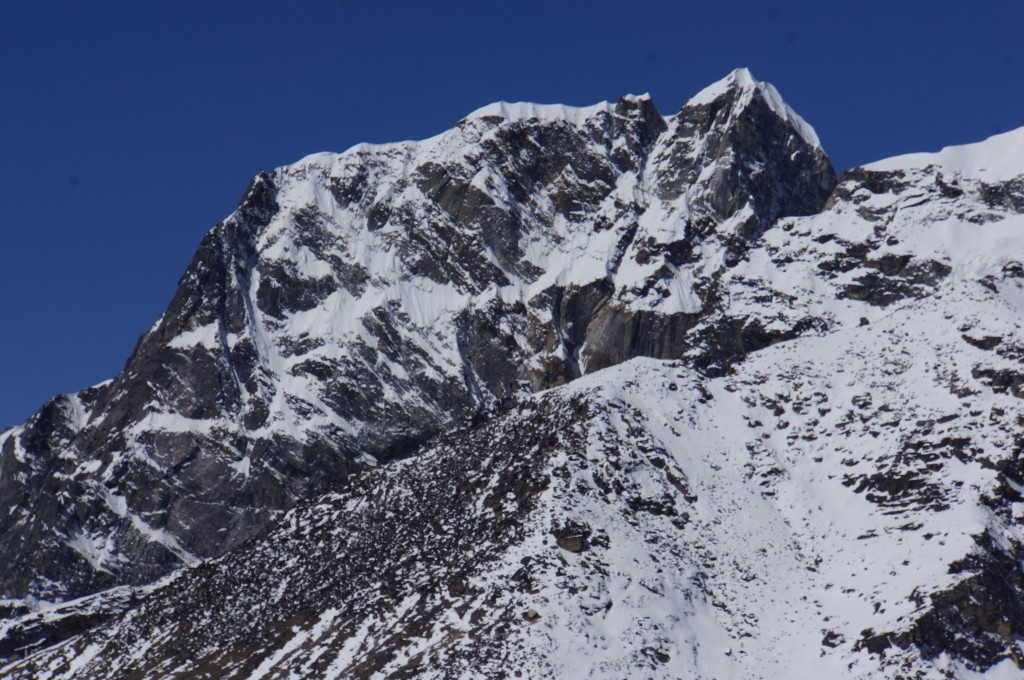 "Our summit will be Lobuche East, the snow bump on the left, just right of the dark rock band. The ""true"" summit takes much longer to achieve, and is not on our agenda this time."