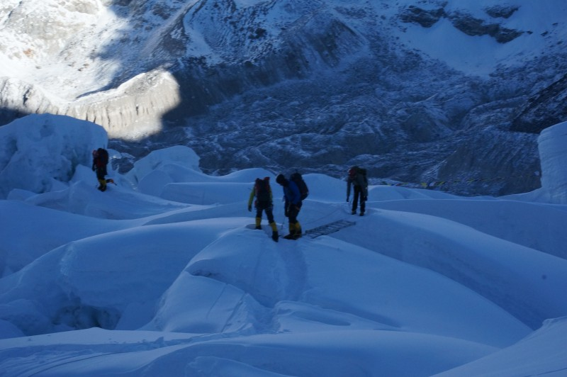 Some ladders are fixed horizontally to cross wide crevasses.  (Photo: Justin Merle)