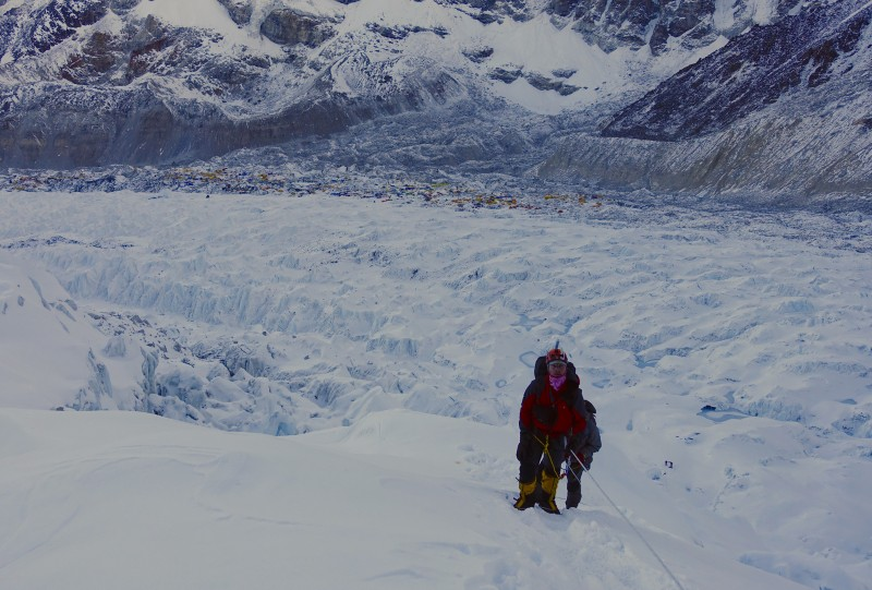 Starting up the icefall, Base Camp in the distance.  Does my expression capture how painful this was?  (Photo: Blake Penson)