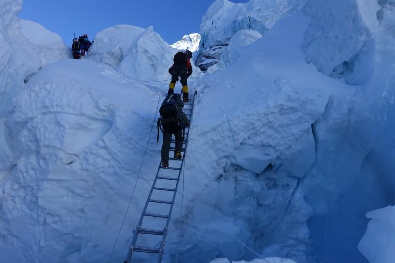 I top out on a short diagonal triple ladder. (Photo: Blake Penson)