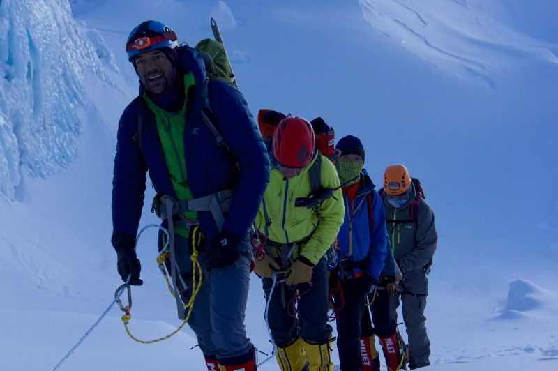 Siva, Andy, and two IMG sherpas pull into the football field.