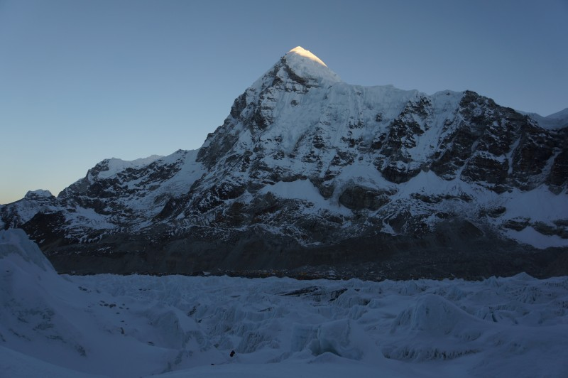 Sunshine hits the top of Pumori behind us as we start up the steep part of the Khumbu Icefall.