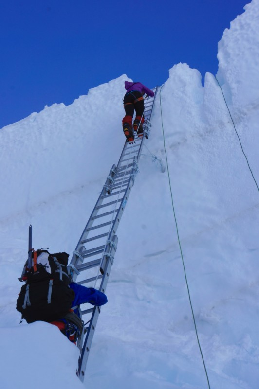 Kim nears the top of the quad ladder.