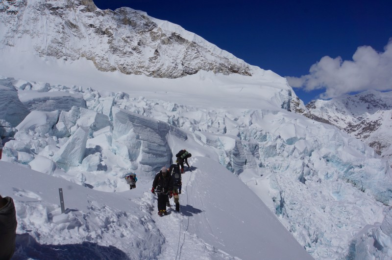 After a break, we prepare to drop down into a jumble of popcorn seracs below the 5-ladder-section.
