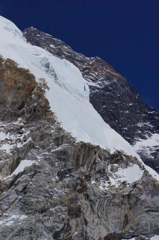 Summit of Everest hiding behind the west shoulder... the Hillary Step, cornice traverse, and south summit seem pretty bare of snow at the moment.