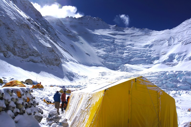 Lhotse cloaked in white, above one of our tents at C2. O2 tanks stacked on the left.