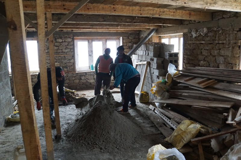 The basement, intended for storage, being sealed with concrete mixed by hand.