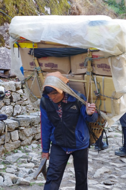 The loads carried by these porters are simply unbelievable. (Photo: Kim Hess)