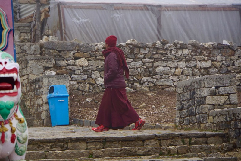 A monk at the monastery gate.