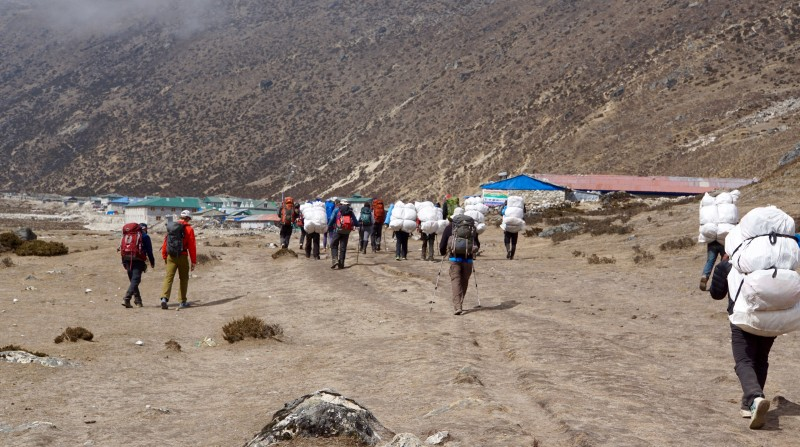 Porters pull into Pheriche with our kit. Yes!