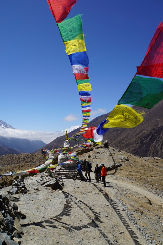 Prayer flags at a stupa on the moraine ridge.