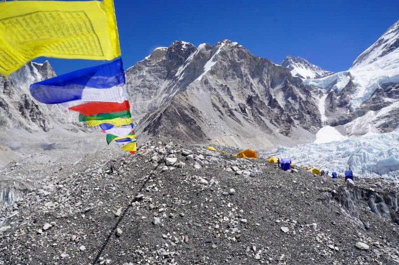 Prayer flags stretch many meters to neaby hilltops.