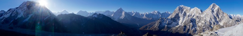 Panorama of the view from below crampon point. Sun just peeking out from behind the Everest massif (Nuptse).