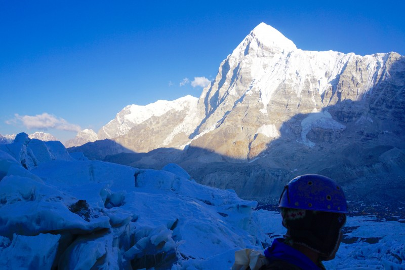Sunlight hits Pumori across the valley long before it reaches us in the shadow of Everest.