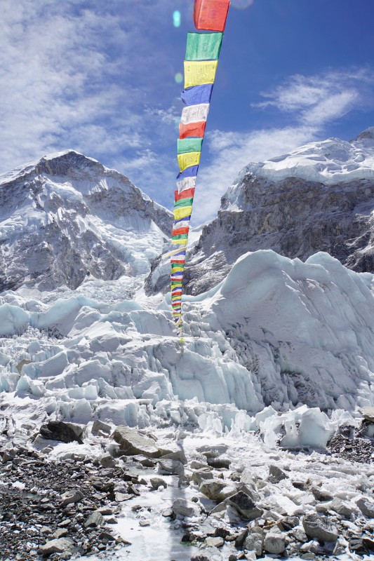 Prayer flags stretch to the glacier.