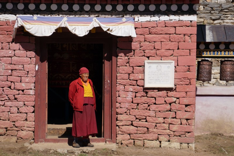 A monk at the monastery gate.  (Photo: Justin Merle)