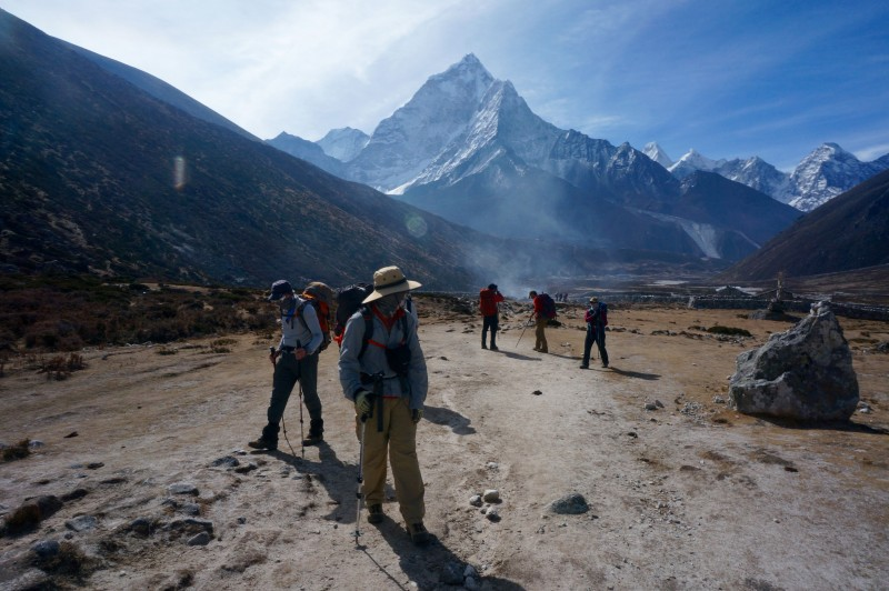 Moving up the valley. Yak dung smoke and Ama behind us. (Photo: Justin Merle)
