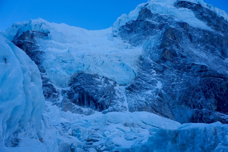 Hanging glaciers on Nuptse show themselves in the early dawn light. (Photo: Justin Merle)