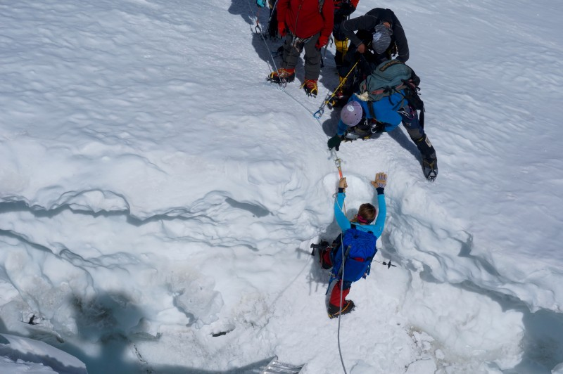 Kim must descend into a crevasse before she tackles this roller face. Nice. (Photo: Justin Merle)