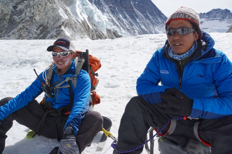 Two IMG Sherpa pause on their way down from Camp 2.
