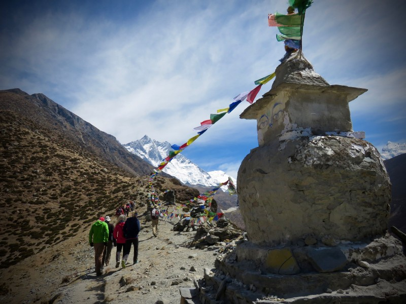 Prayer flags stretch towards our objective. (Photo: Chris Hagerty)
