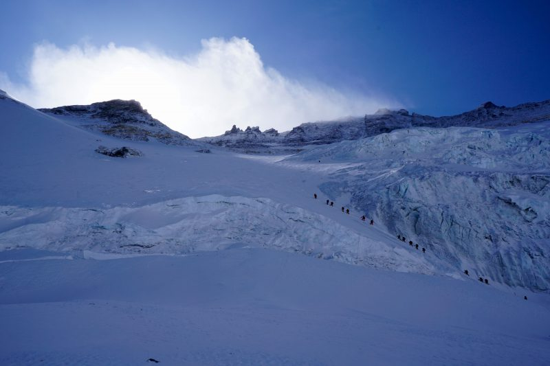 Climbers from other expeditions begin to exit the 'schrund.
