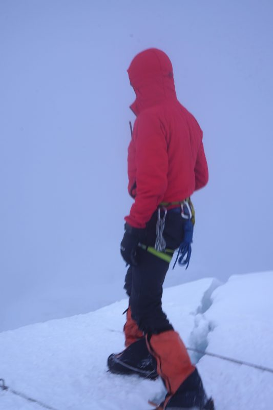 Justin checks the route from the top of the headwall.