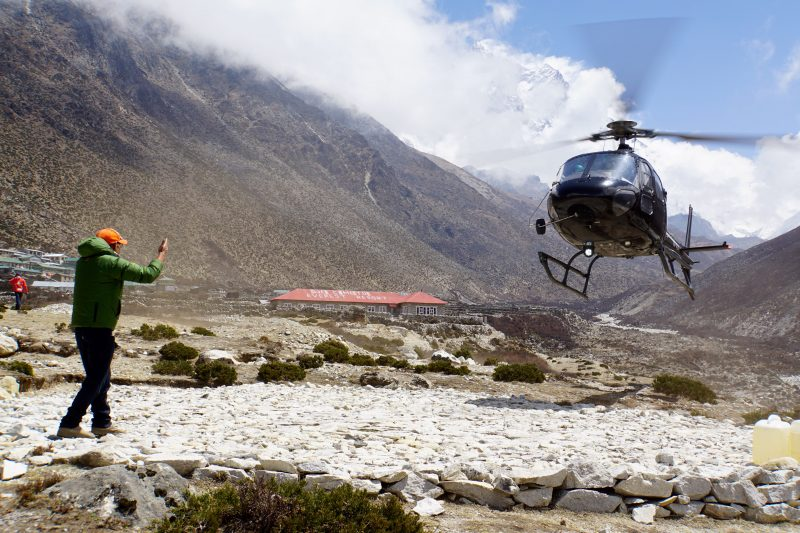 Our friends' Manang chopper arrives first.