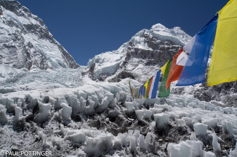 These prayer flags are a hassle during our climbs, because they swing low enough to catch our ice axes strapped to our backpacks. During the day, though, they certainly are beautiful.