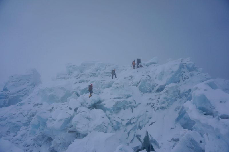 Me on the left, Pasang Kami second from left, and two climbers from another team on the swell of ice just beyond the Sea of Destruction. (Photo: Justin merle)