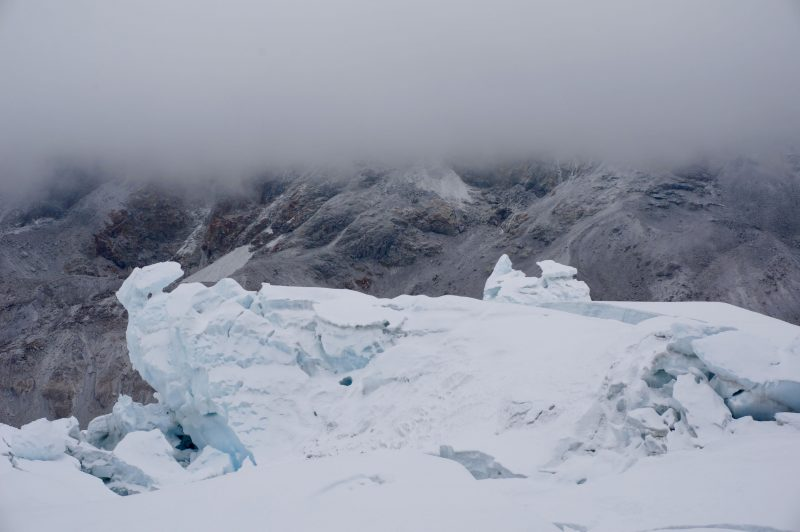 Funny moment as we break out from below the cloud layer, revealing a gloomy, cold valley below. (Photo: Justin merle)