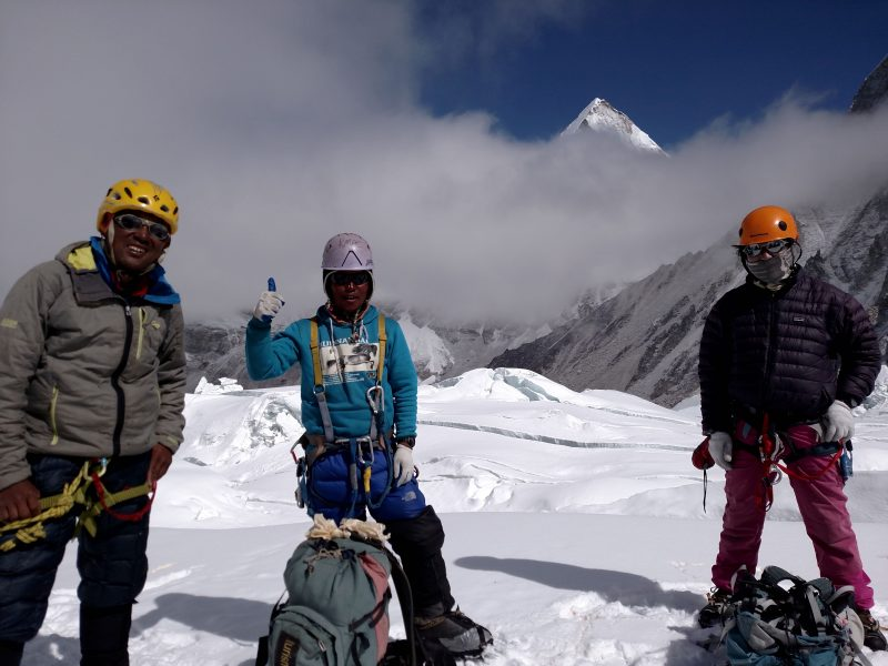 Pemba Gyaltzen, Ang Pemba, and Mingma Tenzing relaxing on the trail to Camp 2. (Photo: Nicky Lowry)