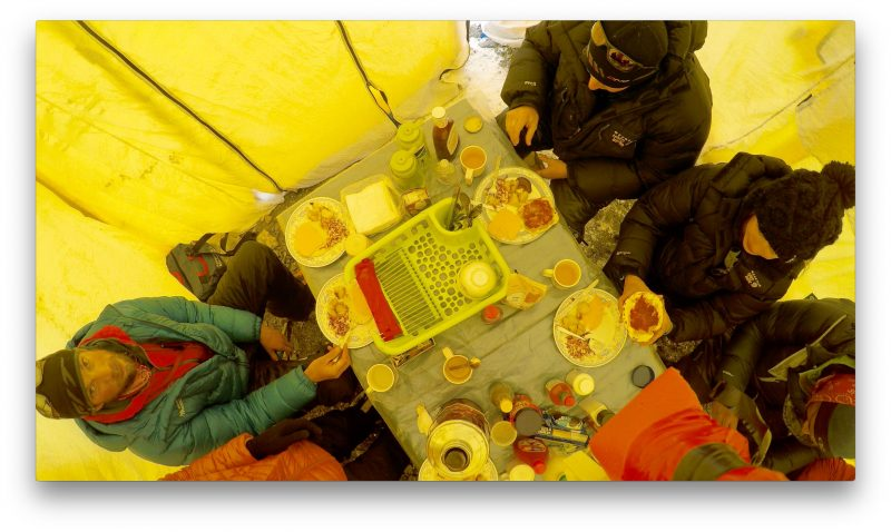 Ceiling shot of the meal tent. Justin seems not to be amused. (GoPro Screenshot)