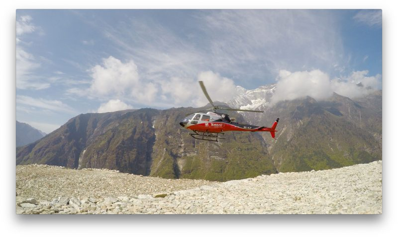 Our ride arrives at the helipad above Namche. (GoPro Screenshot)