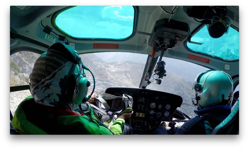 Namche is visible through the windshield. (GoPro Screenshot)